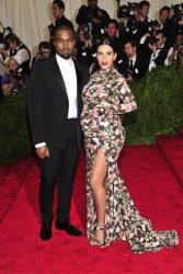 Kanye West and Kim Kardashian attends The Metropolitan Museum of Art's Costume Institute benefit celebrating PUNK: Chaos to Couture on Monday May 6, 2013 in New York.