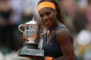 Serena Williams holds the trophy after defeating Russia's Maria Sharapova in the women's final of the French Open tennis tournament, at Roland Garros stadium in Paris, Saturday June 8, 2013.