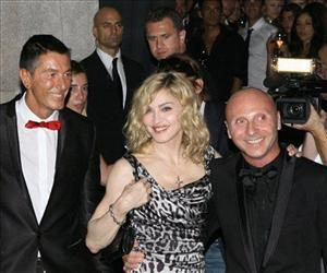 Madonna stands between Stefano Gabbana, left, and Domenico Dolce, right, at the entrance of their Gold restaurant in Milan, Italy, Tuesday, July 14, 2009.