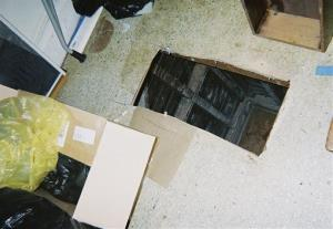 This undated photo released by the San Francisco Office of the District Attorney shows a hole cut into the floor of a San Francisco apartment.