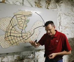 Investor Coby Cullins stands next to a map of the Vivos Shelter and Resort in Atchison, Kan., Tuesday, June 18, 2013.
