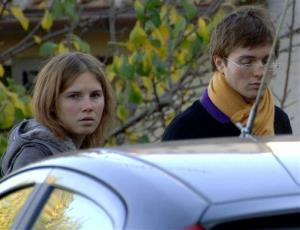 This photo taken Nov. 2, 2007, shows Amanda Knox and Raffaele Sollecito looking on outside the rented house where 21-year-old British student Meredith Kercher was found dead, in Perugia, Italy.
