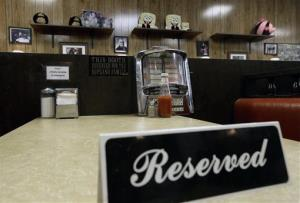 A reserved sign sits on the booth featured in the last scene of  The Sopranos at Holsten's ice cream parlor in Bloomfield, NJ.
