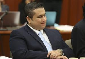 George Zimmerman smiles as attorney Mark O'Mara questions potential jurors Thursday.