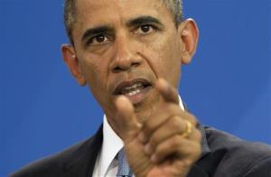 President Obama gestures during a news conference in Germany on June 19.