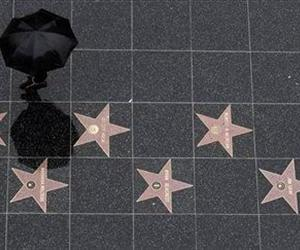 Tourists walk on the Hollywood Walk of Fame in the Hollywood section of Los Angeles; a woman was stabbed to death there this week.