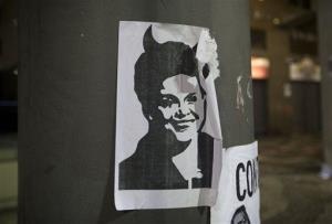 An image depicting Brazil's President Dilma Rousseff with devil horns is displayed on a post in Rio de Janeiro, Brazil.