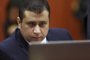 George Zimmerman looks at a laptop during jury selection last week.