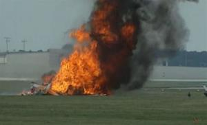 This photo provided provided WHIO-TV shows a plane after it crashed Saturday at the Vectren Air Show near Dayton, Ohio.