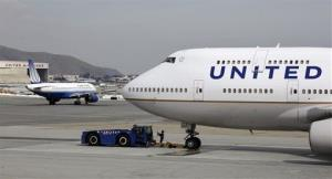 United Airlines planes taxiing at San Francisco International Airport.