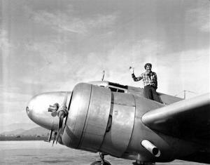 American aviatrix Amelia Earhart waves from the Electra in 1937.