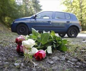 In this Sept. 8, 2012 file photo flowers are seen at the crime scene where four people have been shot to death in a British-registered car, in a forest in the Alps, near Chevaline, French Alps.