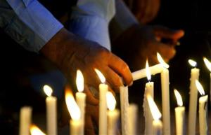 Members of the Pakistan Association of Tour Operators light candles in memory of foreign tourists killed by Islamic militants.