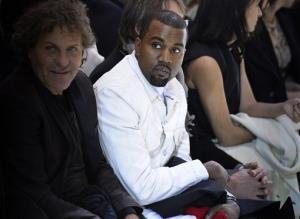 Kanye West attends the fashion designer Martin Margiela's Spring/Summer 2013 Haute Couture fashion collection, in Paris, Wednesday, Jan. 23, 2013.