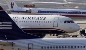 A US Airways jet at the Philadelphia International Airport in this file photo.