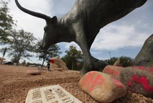 Memorials rest at the feet of the statue at the National Ranching Heritage Center in Lubbock, Texas.