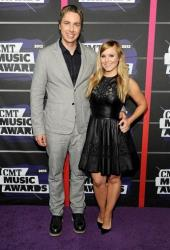 Dax Shepard, left, and Kristen Bell arrive at the 2013 CMT Music Awards at Bridgestone Arena on Wednesday, June 5, 2013, in Nashville, Tenn.