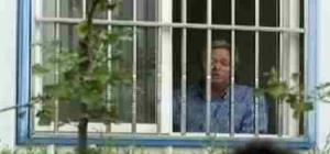 A frame grab of US executive Chip Stames, in his barred window office in Beijing.