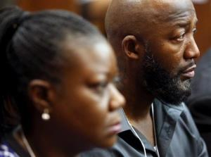 Trayvon Martin's parents Tracy Martin, right, and Sybrina Fulton listen while witness Rachel Jeantel gives her testimony.