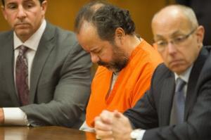 Ariel Castro sits before a judge with his defense attorneys, Craig Weintraub, left, and Jaye Schlachet during a pretrial hearing on Wednesday, June 19, 2013, in Cleveland.