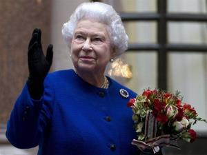 Britain's Queen Elizabeth II looks up and waves to members of staff of The Foreign and Commonwealth Office as she ends an official visit which is part of her Jubilee celebrations in London.