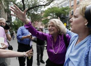 Edith Windsor, left, the plaintiff in the DOMA case, arrives at the LGBT Center in New York Wednesday.
