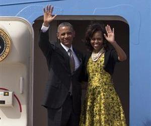 US President Barack Obama and First Lady Michelle Obama wave as they board Air Force One to depart for South Africa, in Dakar, Senegal, Friday, June 28, 2013