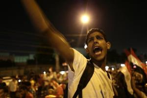 Opponents of Egypt President Mohamed Morsi protest outside the defense ministry in Cairo Friday.