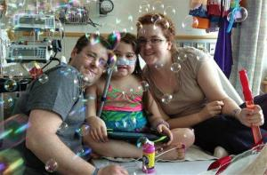 In this May 30 photo, Sarah Murnaghan is seen with parents Fran and Janet.