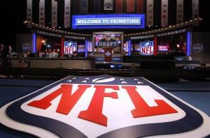 A large NFL logo decorates the stage before the first round of the NFL football draft in April.
