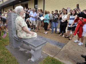 Gael Murphy of Tampa poses on the newly unveiled atheist monument after a ceremony Saturday, May 29, 2013, at the Bradford County Courthouse in Starke, Fla.