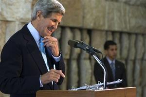 Secretary of State John Kerry smiles at a question from a reporter during a news conference in Tel Aviv, Israel, on Sunday, June 30, 2013.