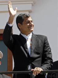 Ecuador's President Rafael Correa greets passersby from the balcony of the presidential palace, in Quito, Ecuador, Monday, June 24, 2013.