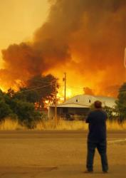 Dean Smith watches as the Yarnell Hill Fire encroaches on his home.