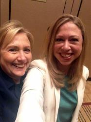 This June 14, 2013 photo released by Chelsea Clinton shows former Secretary of State Hillary Rodham Clinton, left, posing with her daughter Chelsea at a Clinton Global Initiative America event in Chicago.