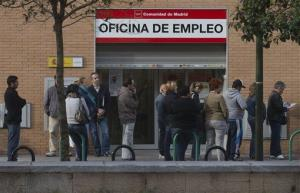 People queue outside an unemployment registry office in Madrid, Spain, in this file photo dated Monday, May 6, 2013.