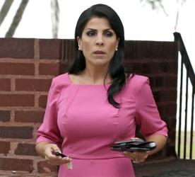 Jill Kelley leaves her home in Tampa, Florida.