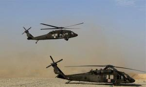 A  Black Hawk helicopter returns from a mission at Forward Operating Base Edi in the Helmand Province of southern Afghanistan, Sunday, Sept. 4, 2011.