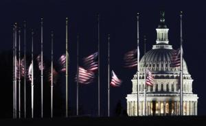 The US Capitol dome backdrops American flags flying at half-staff at the foot of the Washington Monument on the National Mall in Washington, Sunday, Jan. 9, 2011.