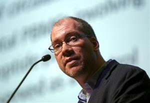 Timothy Henrich of the Harvard-affiliated Brigham and Women's Hospital in Boston speaks at the International AIDS Society Conference 2013 in Kuala Lumpur, Malaysia, Wednesday, July 3, 2013.