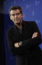 Pierce Brosnan poses at the photo call for the film 'The Ghost Writer' at the International Film Festival Berlinale in Berlin, Germany, Friday, Feb. 12, 2010.