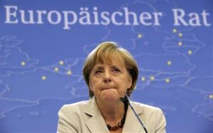 German Chancellor Angela Merkel listens to questions from journalists during a media conference at an EU summit in Brussels on Friday, June 28, 2013.