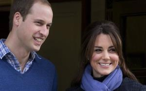 Britain's Prince William stands next to Kate, Duchess of Cambridge as she leaves the King Edward VII hospital in central London.