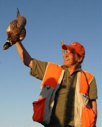 In this Oct. 15, 2010, photo rocker and celebrity hunter Ted Nugent holds up a rooster pheasant he shot at the Dakota Hills Shooting Preserve in Oral, South Dakota.