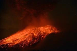 Lava flows from the Popocatepetl volcano after an eruption, seen from Tlamacas, Mexico, early Wednesday, May 15, 2013.