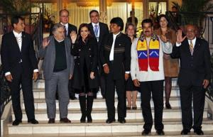 Left to right, Ecuador's Rafael Correa, Uruguay's Jose Mujica, Argentina's Cristina Fernandez, Bolivia's Evo Morales, Venezuela's President Nicolas Maduro and Suriman's President Desi Bouterse.
