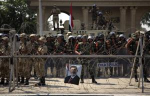 Egyptian soldiers stand guard outside the Republican Guard building in Cairo, Egypt, Friday, July 5, 2013.