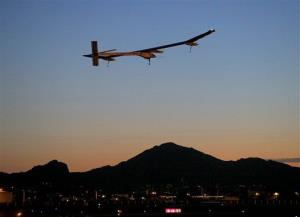 This May 22, 2013 file photo shows the Solar Impulse, piloted by Andr? Borschberg, taking flight at dawn in Phoenix.
