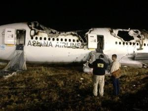 NTSB investigators conduct a first site assessment overnight of the Asiana Airlines flight 214 that crashed at the San Francisco International Airport.
