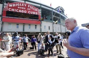 Illinois Gov. Pat Quinn speaks to the media outside Wrigley Field, pressing his message that guns and alcohol are a toxic mix.